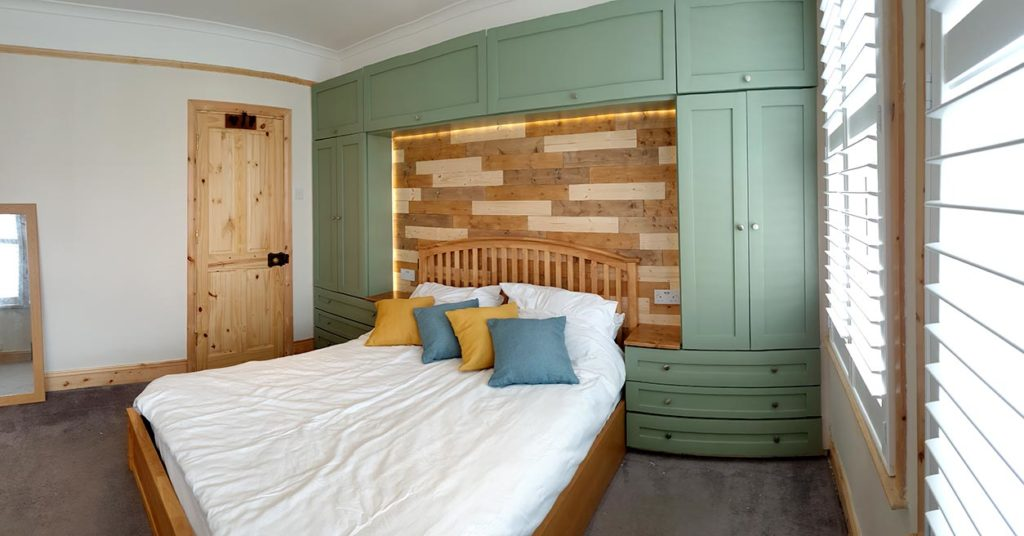 Photograph of a main bedroom after renovation by Made to Alder
