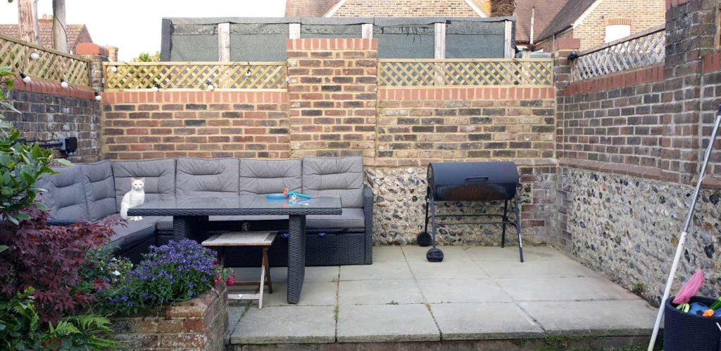 A photograph of a garden wall after renovation by Made to Alder.