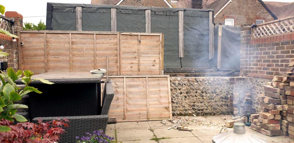 A photograph of a garden wall before renovation by Made to Alder.