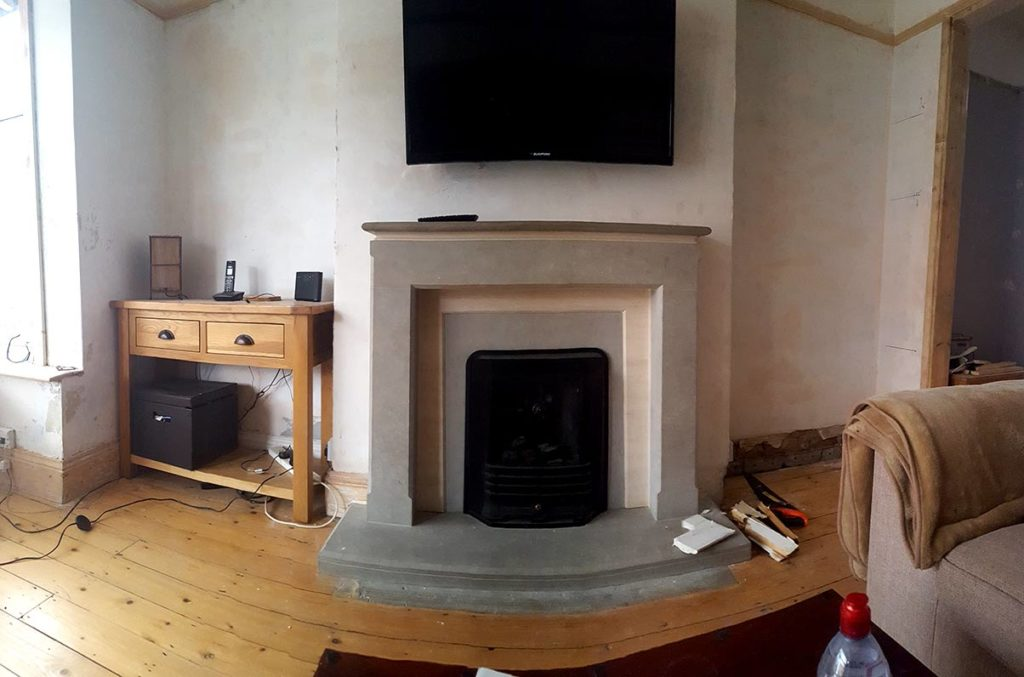 This picture shows the chimney breast and alcoves before Made to Alder built custom cupboards and shelving.