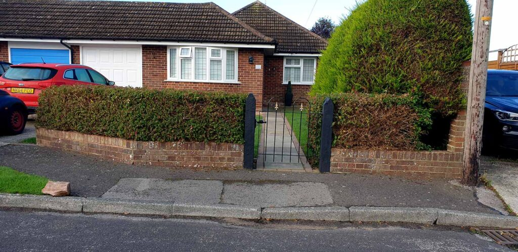Before hedge removal and iron fence installation