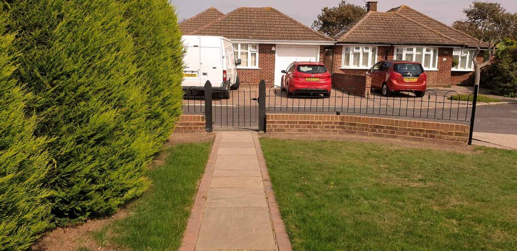 After hedge removal and iron fence installation